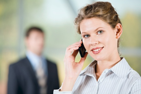 calling communication: Portrait of beautiful business woman calling on mobile Stock Photo