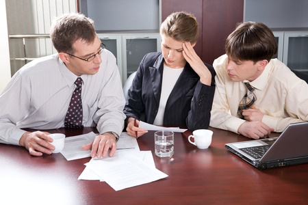 Group of three young business people are discussing a new plan Stock Photo - 8393780