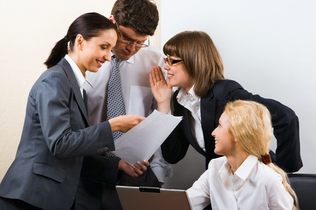 Business team of three people discussing a new project in room photo