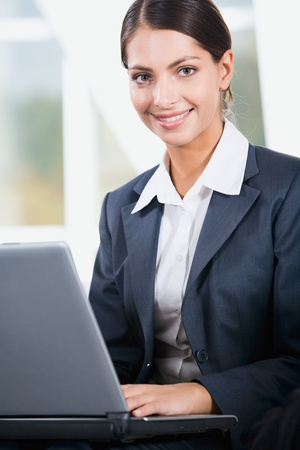 competitive business: Young elegant business woman looking at camera