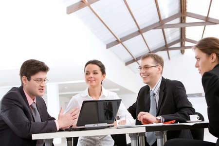Businessman sharing his ideas with partners at meeting photo
