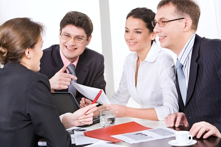sales meeting: Woman sharing her ideas with partners at meeting Stock Photo