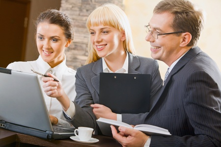 Confident woman is showing creative project to her successful friends Stock Photo - 8393771