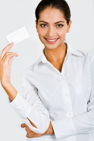 Representative person in the white clothing is holding the business card   photo