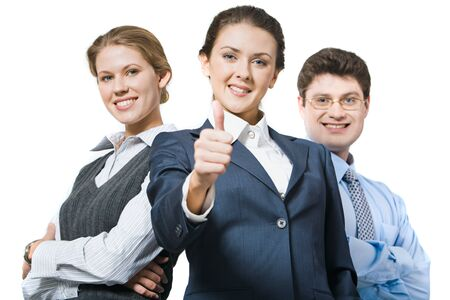business metaphor: Female leader showing sign of okay on the background of her business team Stock Photo