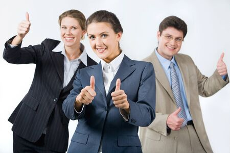 Portrait of successful business team showing sign of okay  photo