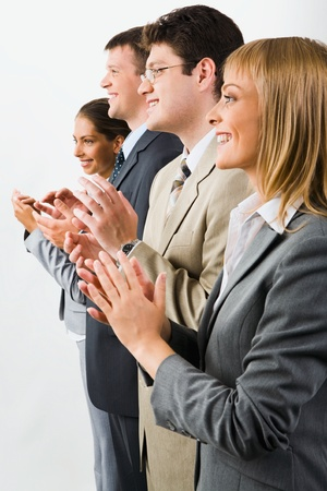 Portrait of business team smiling and applauding on a white background Stock Photo - 8393726