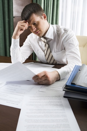 Businessman working with papers in office Stock Photo - 8393475