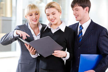 Portrait of confident people discussing a plan at business meeting photo