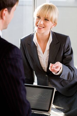 Portrait of business partner talking to her colleague in the office Stock Photo - 8393701