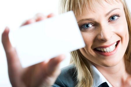 Young beautiful woman presenting her business card photo