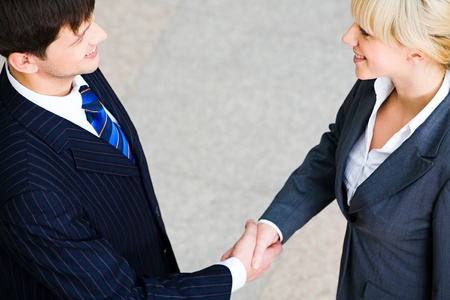 greet: Creative image of people shaking hands making an agreement