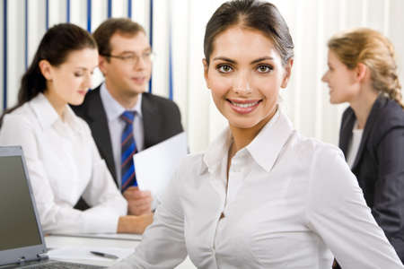 Portrait of young elegant female business leader with charming  smile Stock Photo - 8357377