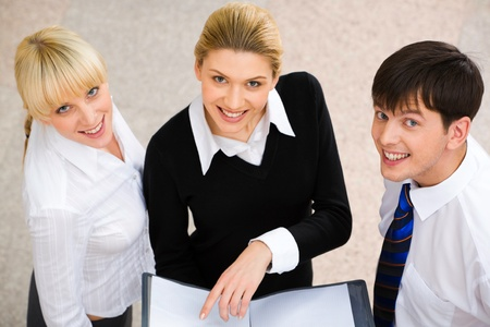 Image of three smiling business people looking at camera  photo