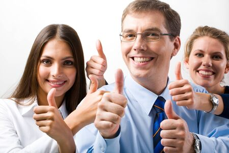 symbols metaphors: Team of three office workers give the thumbs up sign