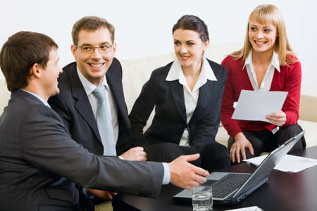 thinking people: Four successful people gathered together for brainstorming Stock Photo