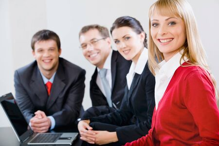 new strategy: Portrait of successful specialists gathered together for discussion of new strategy  Stock Photo