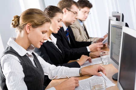 Mature students studying an educational material at training Stock Photo - 8393940
