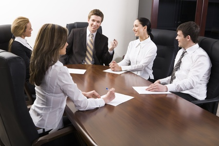 copy room: Team of successful business people are sitting at the table and discussing
