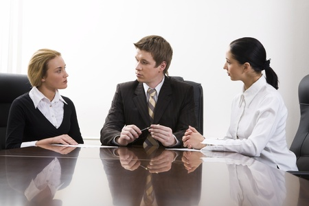 Team of successful business people are sitting at the table and discussing Stock Photo - 8393821
