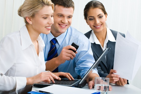 Business team of three people are discussing an ideas photo