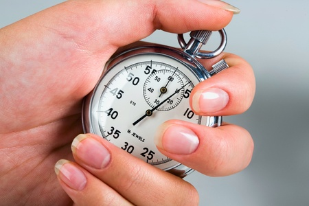 Portrait of female hand holding  the stop-watch Stock Photo - 8393948