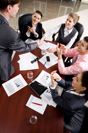 congratulating: Business people congratulating their boss by ovations Stock Photo