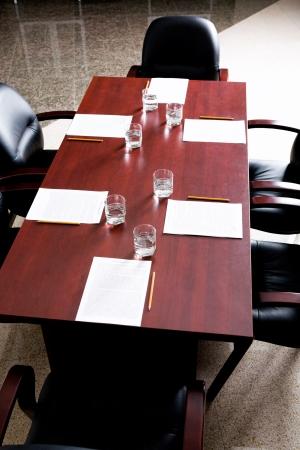 Vertical image of empty board room of directors photo