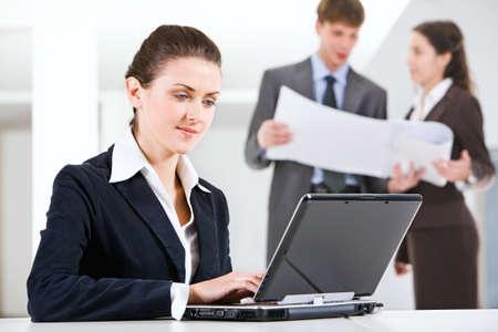 Businesswoman working on laptop photo