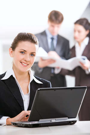 Image of strong woman looking at camera in a working environment photo