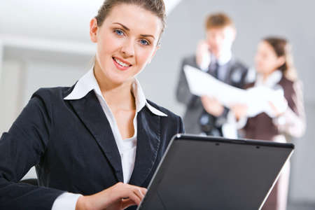 Close-up of specialist with charming smile in the office photo