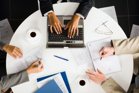 Image of human working hands at business meeting photo