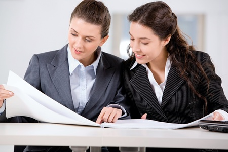 Two business women working together in the office photo