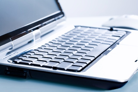 Close-up of opened personal computer on a workplace  photo