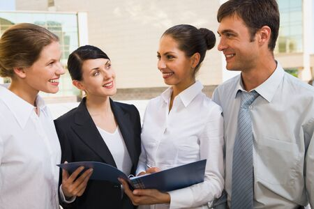 Four successful business people discuss the ideas  Stock Photo - 8394469