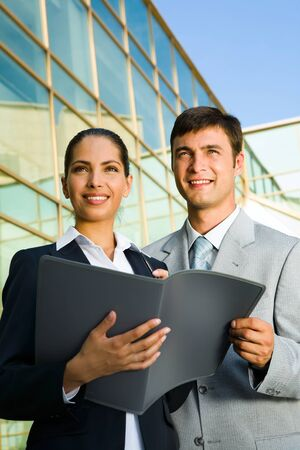 fasten: Young business people fasten their eyes on their future with confidence and impatience