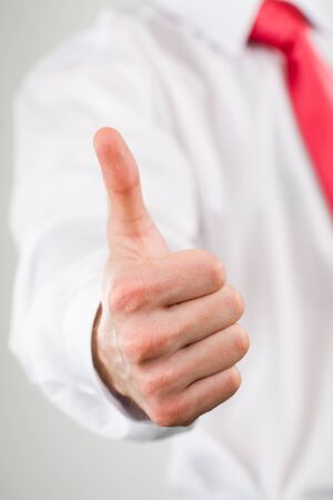 Conceptual image of male hand showing a sign of okay  photo