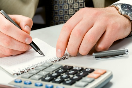 writing instrument: Image of writing instrument in male hands on a workplace