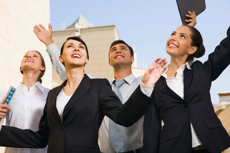won: Four successful business people after they won a grant  Stock Photo