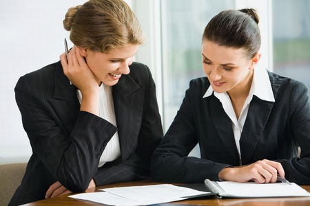 job recruitment: Young woman answers the questions of her potential employer