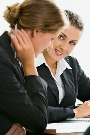 employer: Young woman answers the questions of her potential employer