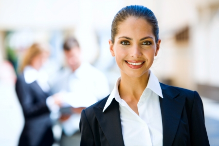 Successful young business woman with charming confident smile  photo