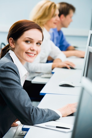 Beautiful smiling student is looking at the camera in a natural educational environment Stock Photo - 8394793