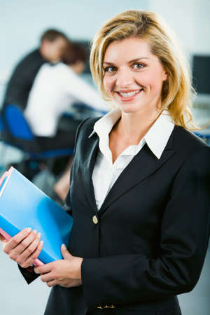 Portrait of smart smiling business woman holding the folders  photo