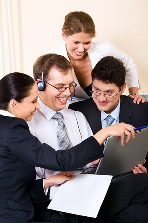Young successful business people gathered together around the laptop discussing ideas Stock Photo - 8394857