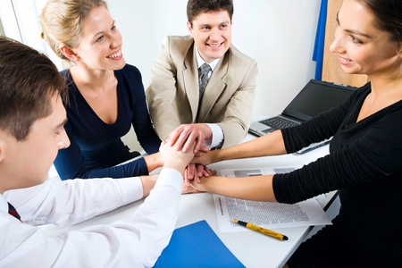 Business team putting their hands on top of each other Stock Photo - 8395081