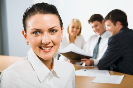 Confident young woman in a business environment photo