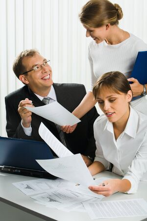 Charming secretary is showing important document  to her boss in the office Stock Photo - 8395501