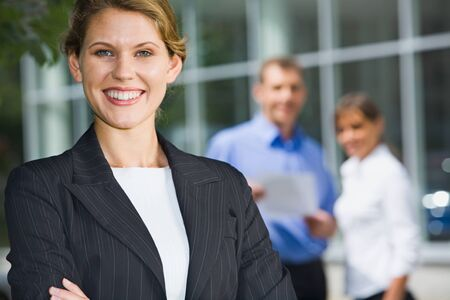 Successful young woman in a business environment photo