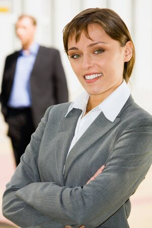 Portrait of pretty woman smiling in a business environment photo